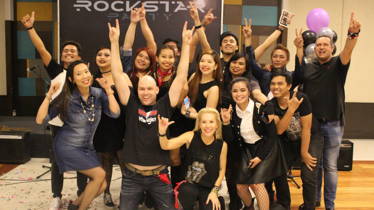 Photo of Beepo employees at the year end party themed Rock and Roll.