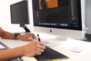 Photo of Graphic Designer/ Web Developer working.